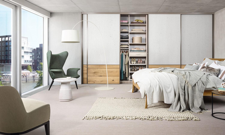 Einbauschrank für Loft mit Oberflächen aus Holz und Beton